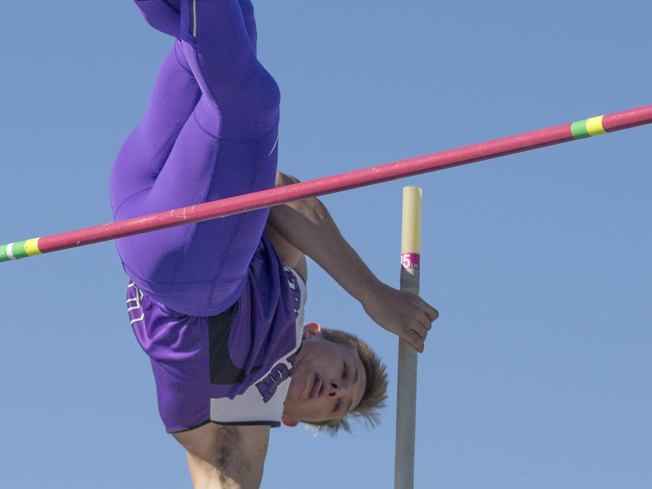 Yerington's Reese Neville competes in the pole vault during the Reed Rotary track meet on Saturday.