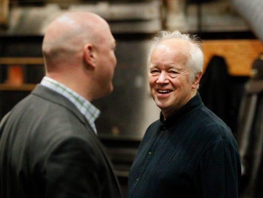 Milwaukee Symphony President Mark Niehaus (left) confers
