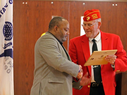 Members of Marine Corps League, Detachment 603 retired five flags representing branches of the U.S. armed forces in a Flag Day ceremony at the Tennessee State Veteran's Home Tuesday. Stephen Baird, right, then presented a plaque honoring the occasion to facility director Warren Jasper.