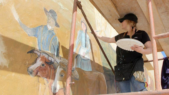 Artist Inga Ojala adds features to mural that celebrates William Bickerton establishing the town of St. John. The mural will feature Bickerton, his wife Dorothy, children (drawn with community children's faces), wagons, horses, native grasses and animals, a Native American and even a tornado.