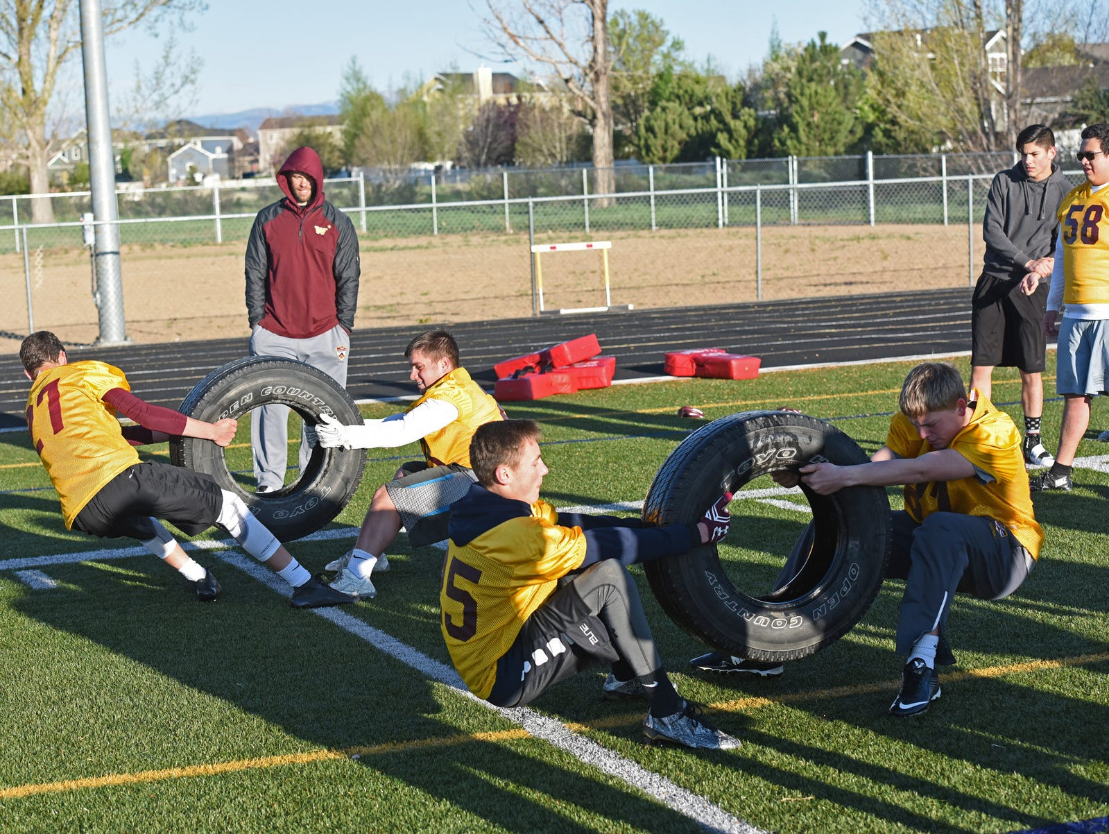 Members of the Windsor High School football team get in an early morning practice Wednesday. The morning practices run from 6:15-7:15 am.