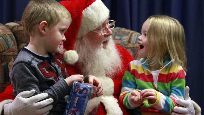 Kids tell Santa what they want for Christmas during a past Polar Express at the Wysor Street Depot.