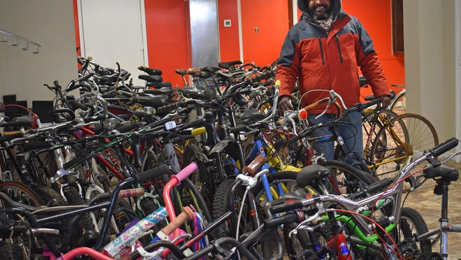 Terry Harrigan looks at the bicycles he has stored in the front room of his new business, Pedal and Floor, at 221 Broadway in Newburgh. Harrigan plans to open the shop in about a month. The store will sell and repair bicycles, bicycle parts and gear.