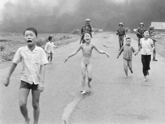 This Pulitzer Prize-winning 1972 photo of naked 9-year-old Kim Phuc and other terrified Vietnamese children fleeing from a napalm attack is one of the most memorable photos of the 20th century.