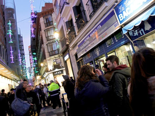 People line up at one of the most popular lottery shops