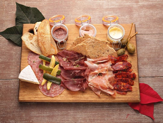 The Roasted Garlic Aioli is part of the charcuterie board from the Market by Jennifer's in Phoenix.