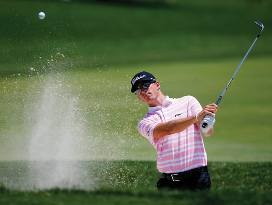 Morgan Hoffmann hits out of the sand trap on the first