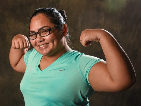 Recruit Holi Tainatongo, 23, brings on the gunshow for the Bridal Boot Camp battle during a photo shoot at the Pacific Daily News studio on Friday, Dec. 30, 2016.