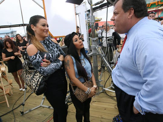 "In this May 24, 2013, file photo, New Jersey Gov. Chris Christie, right, speaks with Nicole ""Snooki"" Polizzi, center, and Jenni ""JWoww"" Farley, left, cast members of MTV's reality television show ""Jersey Shore,"" while marking the New Jersey shore's seasonal reopening for the first time since Superstorm Sandy."