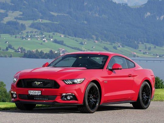 Henry Payne Ford Mustang Sales Roar Overseas