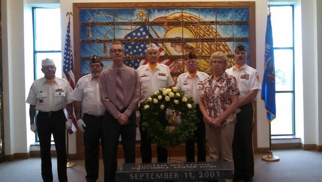 VFW Post 1904 members pose with Toby Flaget (not in uniform) during his recent visit at Ledgeview Cemetery on Fond du Lac County K.