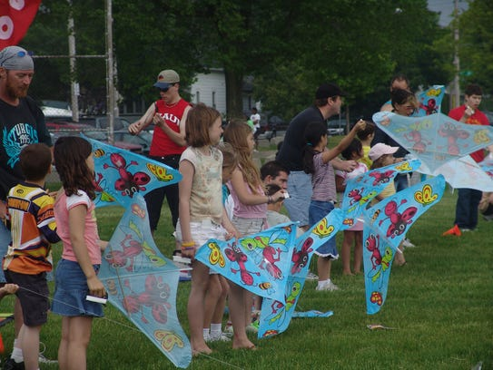 Kids line up to launch their kites at the Kids Mad