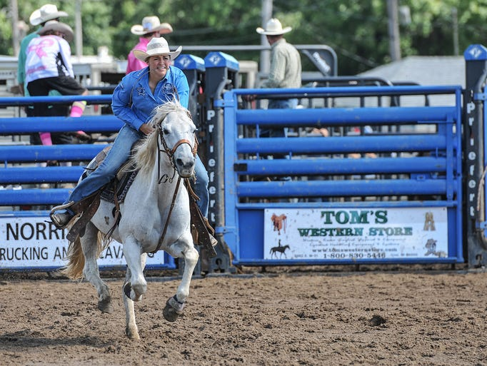 This rider gallops at full speed in the goat tying