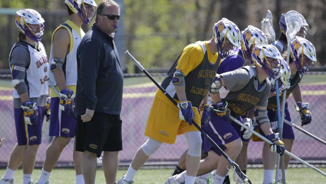 In this April 28, 2016, file photo, Albany lacrosse coach Scott Marr runs practice in Albany.