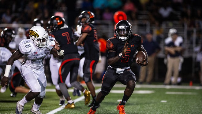 Lely High School's Henderson Francois  takes the ball during a game against Naples High School in Naples, Fla. on October 5, 2018.