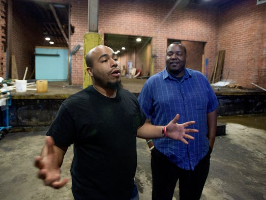 Jonathon Peterson, left, and Charles Lee give a tour