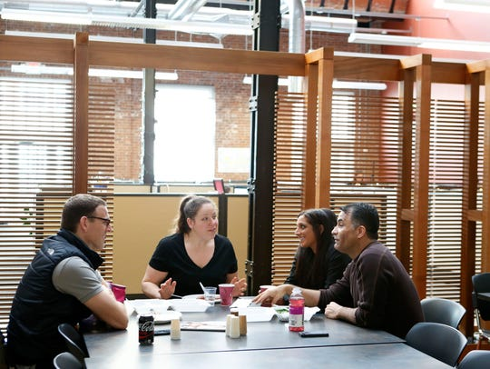 Colleagues chat during lunch in the cafeteria at Lockard