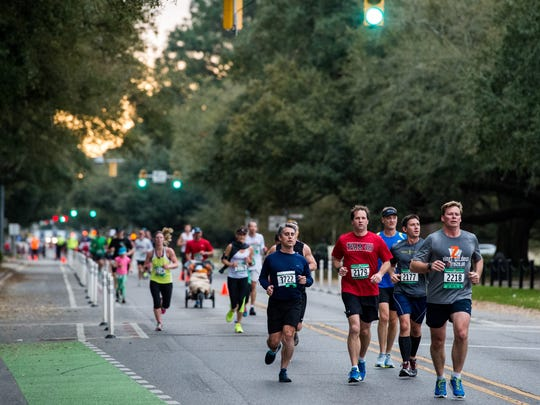 FILE - Runners compete in the full and half marathon in the Zydeco Marathon.
