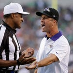 Baltimore Ravens coach John Harbaugh, right, argues a call with referee Jerome Boger during a preseason game against the Philadelphia Eagles on Aug. 22, 2015, in Philadelphia.
