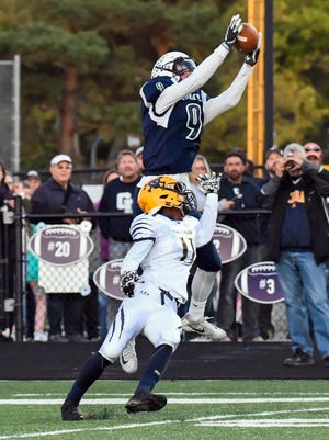 Gull Lake WR Niner Stark (9) leaps for a pass and scores midway through the first quarter of play Friday night.