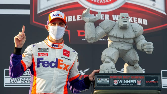 Denny Hamlin celebrates in Victory Lane after winning the NASCAR Cup Series auto race at Dover International Speedway, Saturday, Aug. 22, 2020, in Dover, Del.