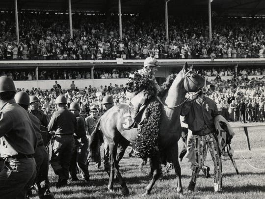 The winner of the 1970 Kentucky Derby, Dust Commander with the blanket of roses in 1970.