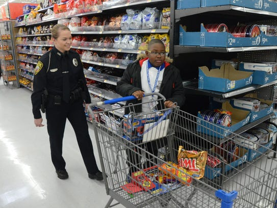 Adaemian Carter, 8, selected some chips and candy as