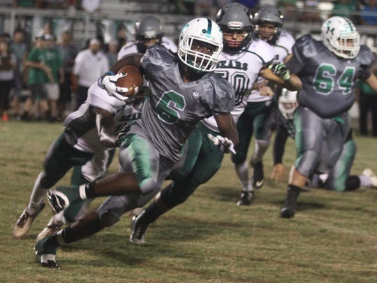 Darrian Felix of Fort Myers runs for a touchdown against Palmetto Ridge on Friday night at Fort Myers High School in November.