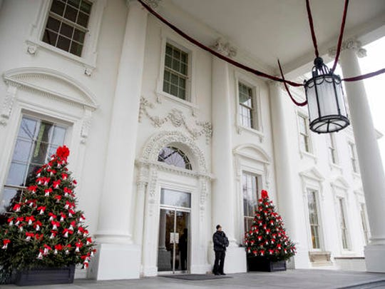 The North Portico of the White House is decorated during a preview of the 2016 holiday decor, Tuesday, Nov. 29, 2016, in Washington.