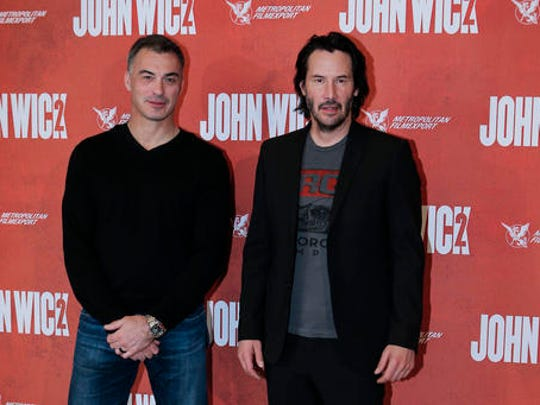 Director Chad Stahelski, left, and actor Keanu Reeves pose for the media as they arrive for the French premiere for 'John Wick 2' in Paris, Tuesday, Feb. 7, 2017.