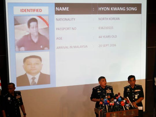 Malaysia's Inspector-General of Police Khalid Abu Bakar, center left, speaks in front of the details of one of the suspects Hyon Kwang Song as Selangor Police Chief Abdul Samah Mat, center right, listens during a press conference at the Bukit Aman national police headquarters in Kuala Lumpur, Malaysia, Wednesday, Feb. 22, 2017. Malaysia's police chief says a North Korean Embassy official is among eight North Korean suspects in last week's fatal poisoning of the half brother of Pyongyang's leader Kim Jong Un in Kuala Lumpur's airport.