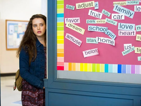 """This image released by Netflix shows Katherine Langford in a scene from the series, """"13 Reasons Why,"""" about a teenager who commits suicide. The stomach-turning suicide scene has triggered criticism from some mental health advocates that it romanticizes suicide and even promoted many schools across the country to send warning letters to parents and guardians. The show's creators are unapologetic, saying their frank depiction of teen life needs to be """"unflinching and raw."""""""