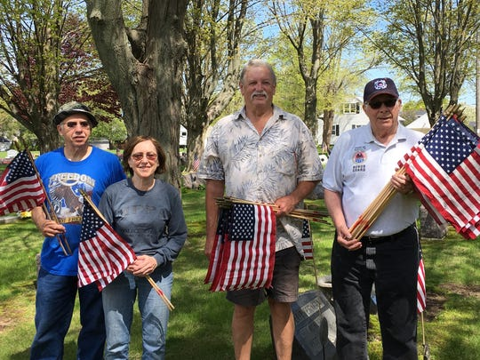 AMVETS Post 99 and Auxiliary laid American flags at all veterans' graves in Calvary Cemetery in time for Memorial Day 2018. Pictured are, from left: Ed and Chris Mahloch, Roger R. Dufek and Larry Yax.