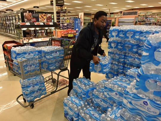 Jakevious Whice purchases bottled water at Kroger on I-55 in preparation for the upcoming water line maintenance in Jackson. The city has planned the outage in order to repair several breaks on a concrete water main in northwest Jackson starting Friday at 3 p.m.