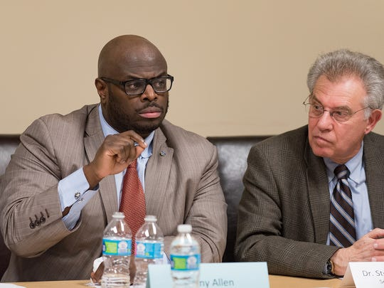 Tony Allen, left, chairman of the Wilmington Education Improvement Commission, and Steven H. Godowsky, secretary of the State Board of Education, answer questions in 2016.