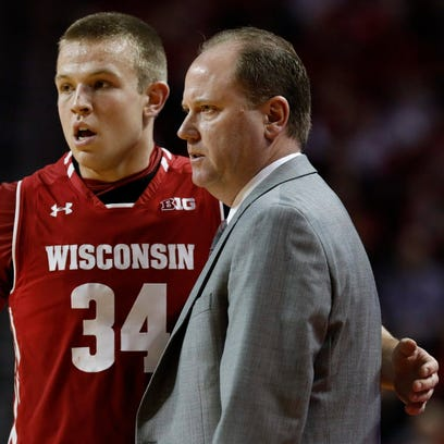 UW men's basketball coach Greg Gard received a one-year