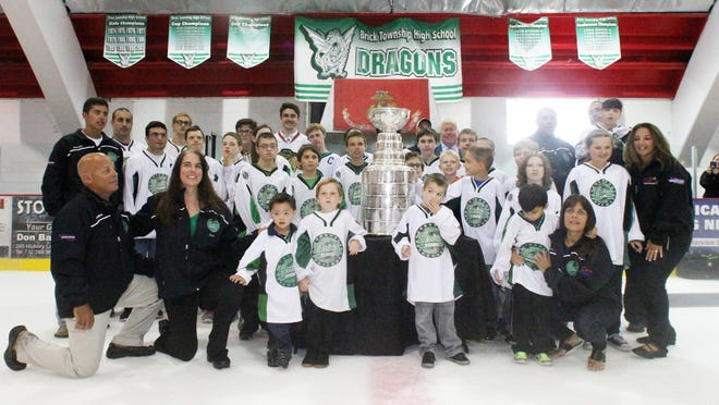 Former CBA High School hockey player and now playing for the Chicago Blackhawk's Trevor van Riemsdyk brings the Stanley Cup to Ocean Ice Palace in Brick on Thursday July 30,2015. Here Riemsdyk poses for a photograph with members of the Brick Stars Hockey Club.