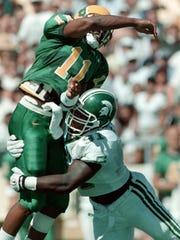 MSU's Robaire Smith tackles Oregon's quarterback Akili