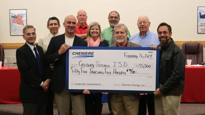(From left) Paul Clore, G-PISD superintendent; trustee Victor Hernandez; government and public affairs manager for Cheniere Energy Will Nichols; trustee Tim Flinn; trustee and board secretary Carrie Gregory; trustee Rey Rojas; trustee and board president Randy Eulenfeld; trustee and board vice president Dean Atkinson; and trustee Gilbert Cortinas.