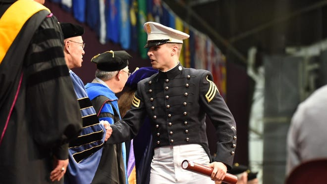 A Norwich graduate receives his degree Saturday.