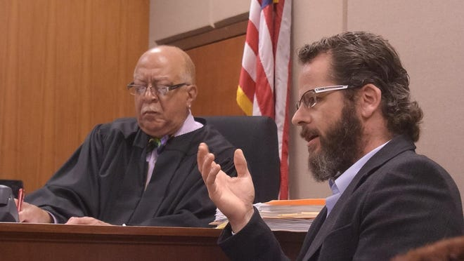 Former state Rep. Todd Courser testifies Wednesday in Ingham County District Court in Lansing.