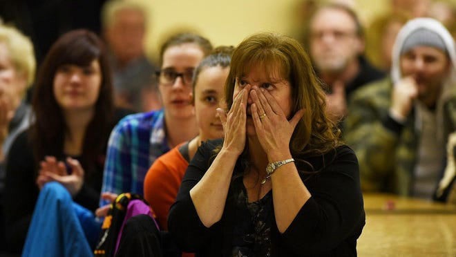 Ann Stislicki wipes away tears as people gather to support her family during vigil for her missing daughter, Danielle Stislicki, on Thursday. Danielle was last seen Dec. 2.