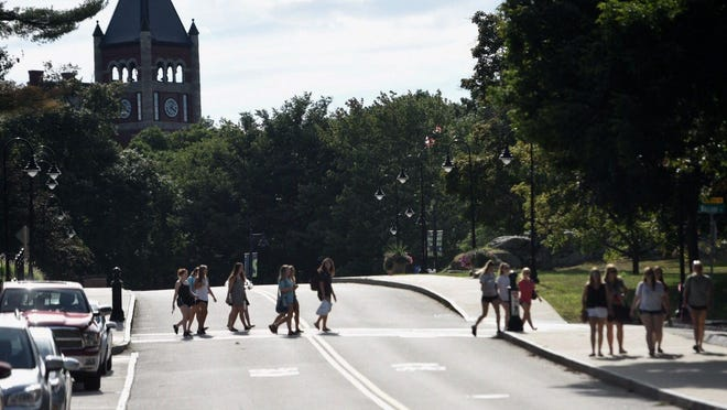Students walk on campus at the University of New Hampshire.