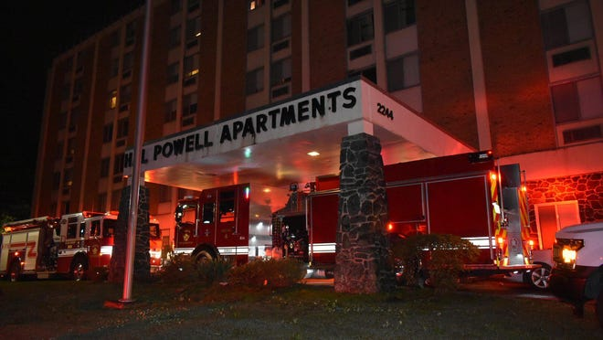 Augusta Firefighters work to contain a fire on the fourth floor of Hal Powell Apartments in downtown Augusta Sunday morning.