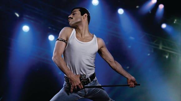 Rami Malek as mustachioed, tank top, slave-bracelet