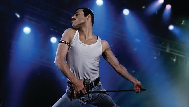 """Rami Malek stars as mustachioed, tank top and slave-bracelet-wearing Freddie Mercury in """"Bohemian Rhapsody."""""""