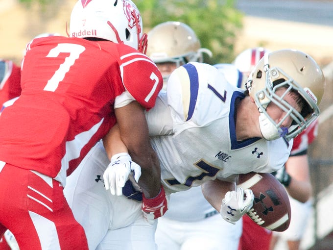 Butler Bears defensive back Demondre Blanks forces Male Bulldogs wide receiver  Ethan Britt to fumble the ball. 29 August 2014