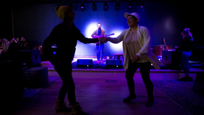 Allison Dobbs and Ellen Gail dance to music from Ian Mahan at Magic Rat Live Music on Saturday, December 16, 2017. The new space, located at the Elizabeth Hotel, will feature weekly live music.