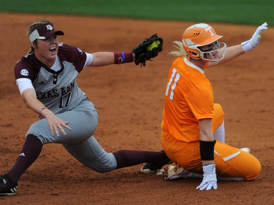Tennessee's Haley Bearden (11) slides safely into second base as Texas A&M's Kristen Cuyos (17) attempts to tag her out during an NCAA Super Regional game between Tennessee and Texas A&M at Sherri Parker Lee Stadium on Saturday, May 27, 2017.