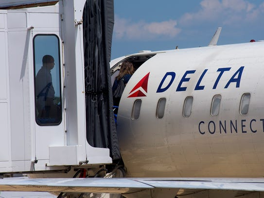 Passengers board a Delta jet at the Montgomery Regional